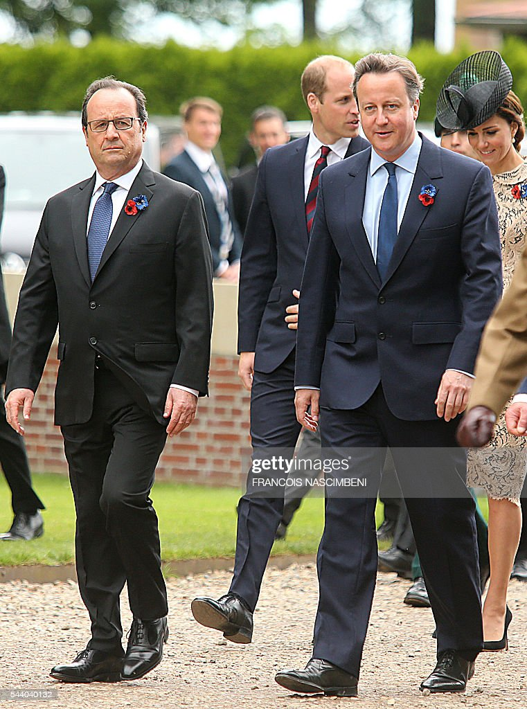 French President Francois Hollande, Britain's Prince William, Britain's Prime Minister David Cameron and Britain's Princess Catherine march towards the Thiepval Memorial on July 1, 2016 to attend a ceremony marking the 100th anniversary of the World War I battle at the River Somme. Under grey skies, unlike the clear sunny day that saw the biggest slaughter in British military history a century ago, the commemoration kicked off at the deep Lochnagar crater, created by the blast of mines placed under German positions two minutes before the attack began at 7:30 am on July 1, 1916. / AFP / FRANCOIS