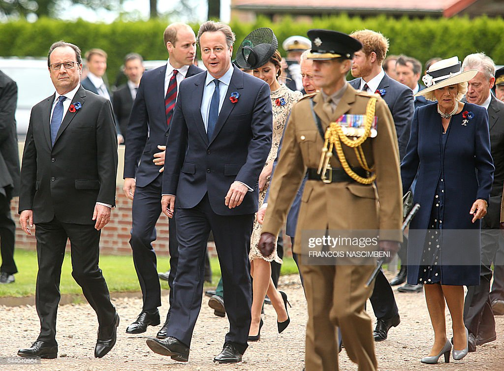 French President Francois Hollande, Britain's Prince William, Britain's Prime Minister David Cameron, Britain's Princess Catherine, Britain's Prince Harry and Britain's Princess Camilla march towards the Thiepval Memorial on July 1, 2016 to attend a ceremony marking the 100th anniversary of the World War I battle at the River Somme. Under grey skies, unlike the clear sunny day that saw the biggest slaughter in British military history a century ago, the commemoration kicked off at the deep Lochnagar crater, created by the blast of mines placed under German positions two minutes before the attack began at 7:30 am on July 1, 1916. / AFP / FRANCOIS