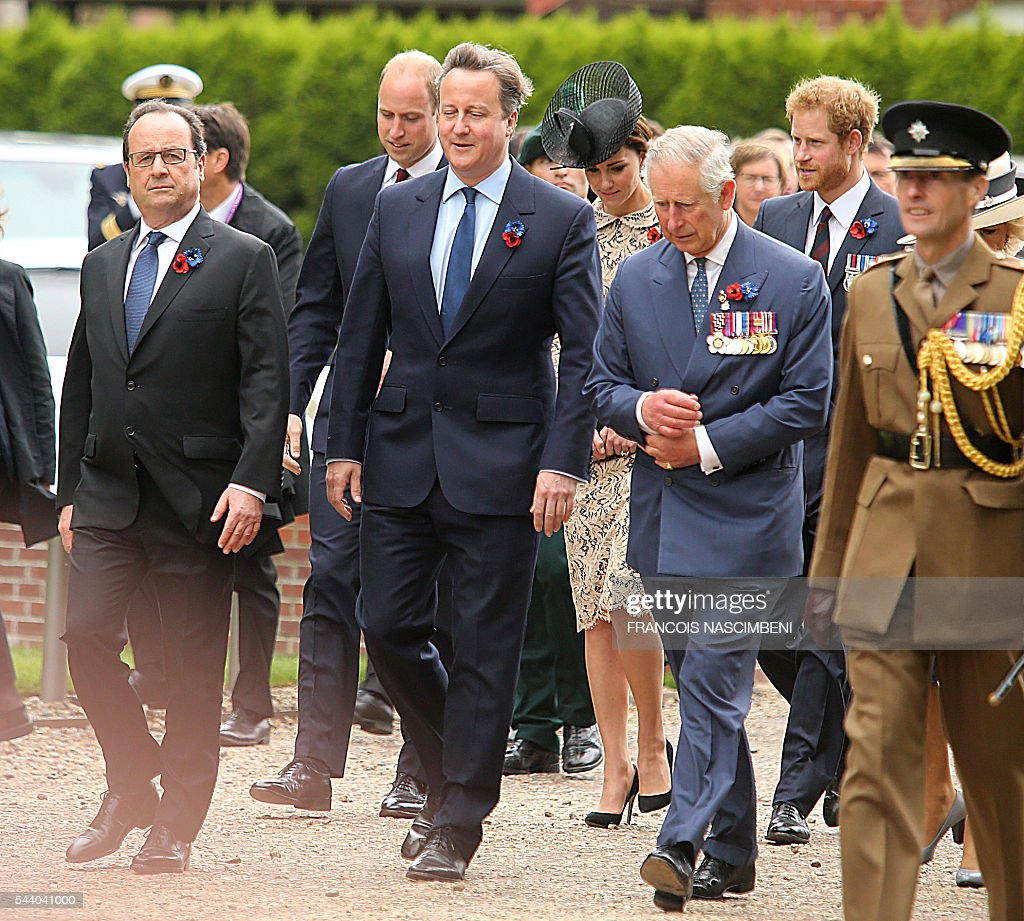 French President Francois Hollande, Britain's Prince William, Britain's Prime Minister David Cameron, Britain's Princess Catherine, Britain's Prince Charles and Britain's Prince Harry march towards the Thiepval Memorial on July 1, 2016 to attend a ceremony marking the 100th anniversary of the World War I battle at the River Somme. Under grey skies, unlike the clear sunny day that saw the biggest slaughter in British military history a century ago, the commemoration kicked off at the deep Lochnagar crater, created by the blast of mines placed under German positions two minutes before the attack began at 7:30 am on July 1, 1916. / AFP / FRANCOIS