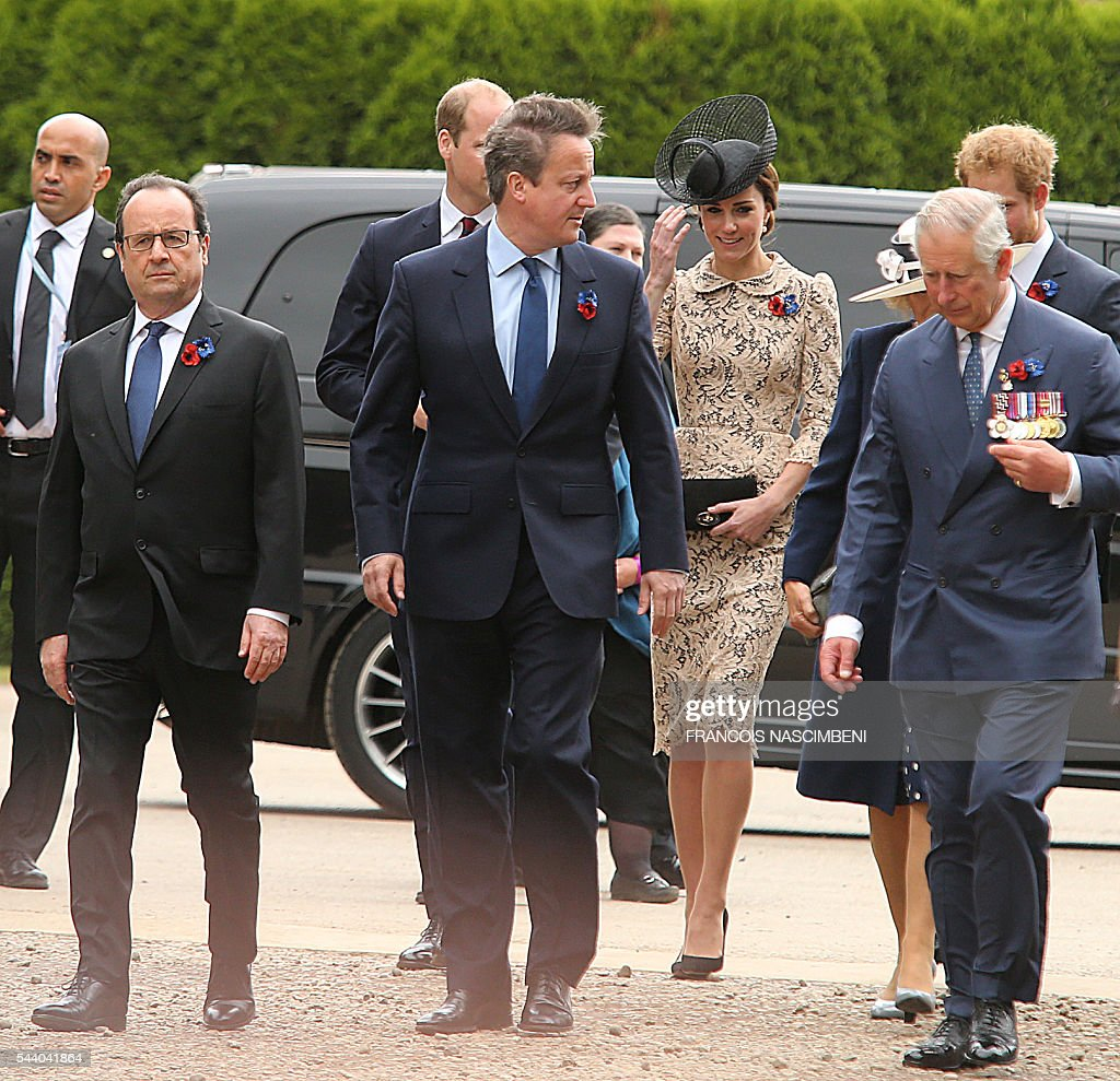 French President Francois Hollande, Britain's Prince William (Rear), Britain's Prime Minister David Cameron, Britain's Princess Catherine, Britain's Prince Charles and Britain's Prince Harry march towards the Thiepval Memorial on July 1, 2016 to attend a ceremony marking the 100th anniversary of the World War I battle at the River Somme, northern France. Under grey skies, unlike the clear sunny day that saw the biggest slaughter in British military history a century ago, the commemoration kicked off at the deep Lochnagar crater, created by the blast of mines placed under German positions two minutes before the attack began at 7:30 am on July 1, 1916. / AFP / FRANCOIS