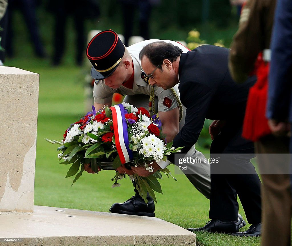 French President Francois Hollande carries flowers during the 100th anniversary of the beginning of the Battle of the Somme at the Thiepval memorial to the Missing on July 1, 2016 in Thiepval, France. The event is part of the Commemoration of the Centenary of the Battle of the Somme at the Commonwealth War Graves Commission Thiepval Memorial in Thiepval, France, where 70,000 British and Commonwealth soldiers with no known grave are commemorated.