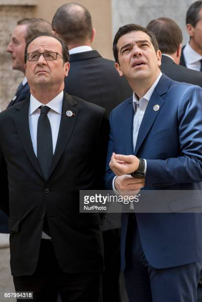French President Francois Hollande center left speaks with Greek Prime Minister Alexis Tsipras center right prior to a group photo in the Cortile di...