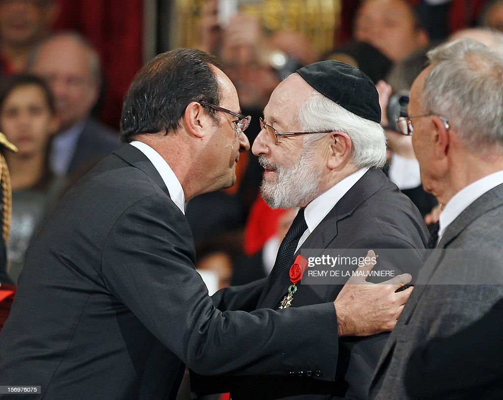 French President Francois Hollande (L) congratulates Alain Goldman, the grand rabbi of Paris, after awarding him with the Grand Officier of the Legion of Honor medal during an award ceremony on November 26, 2012 at the Elysee Palace in Paris. AFP PHOTO POOL REMY DE LA MAUVINIERE