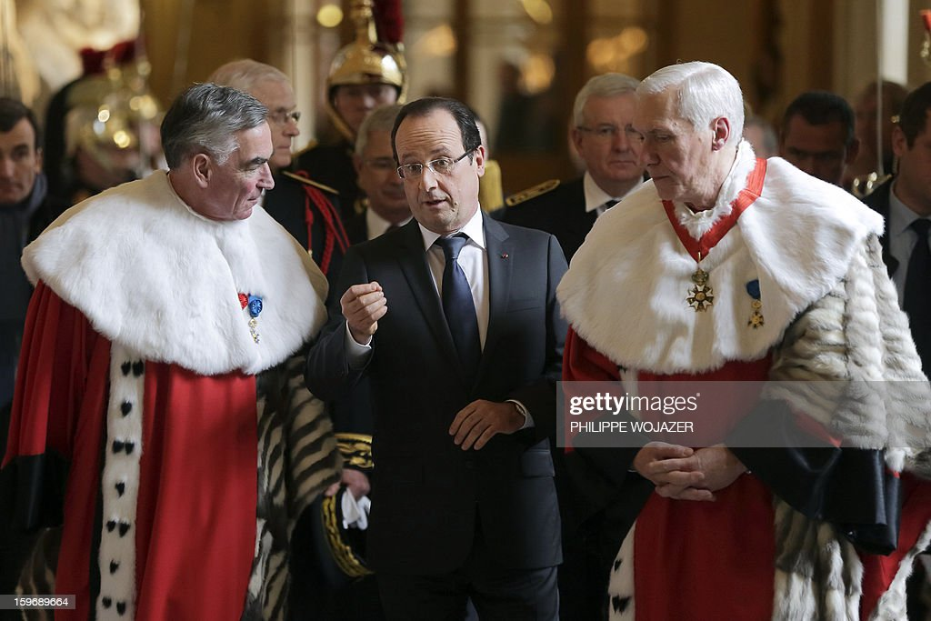 French President Francois Hollande (C), Cour de Cassation First President Vincent Lamanda (R) and General Prosecutor Jean-Claude Marin leave after attending the traditional New Year ceremony which reopens France's highest court (Cour de Cassation) in Paris on January 18, 2013. AFP PHOTO / POOL / Philippe Wojazer