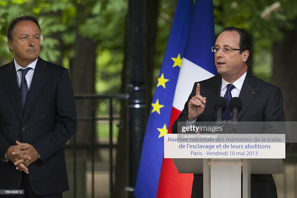 French President Francois Hollande (R) delivers a speech as President of the French Senate, Jean-Pierre Bel looks on during a ceremony marking the abolition of slavery in the Jardins du Luxembourg on May 10, 2013 in Paris, France.