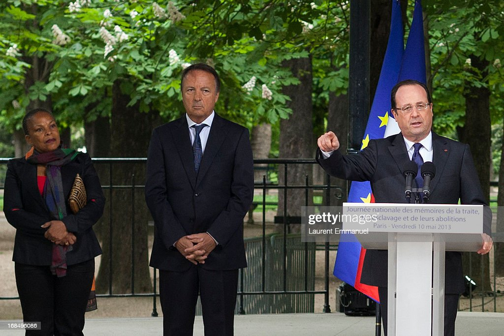 French President Francois Hollande (R) delivers a speech as President of the French Senate Jean-Pierre Bel (C) and French Justice Minister Christiane Taubira look on during a ceremony marking the abolition of slavery in the Jardins du Luxembourg on May 10, 2013 in Paris, France. Taubira Law was passed in May 2001 acknowledging slavery and the Atlantic slave trade as crimes against humanity.
