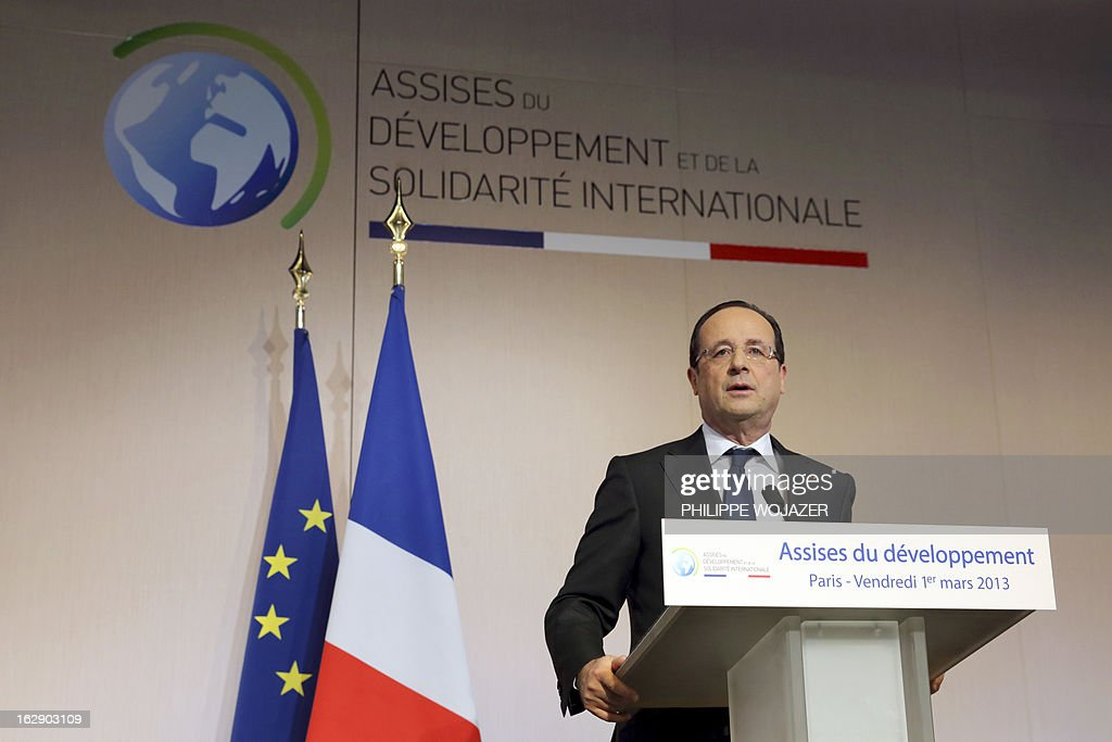 French President Francois Hollande delivers a speech at the International Solidarity and Development meeting in Paris on March 1, 2013. AFP PHOTO / POOL / PHILIPPE WOJAZER