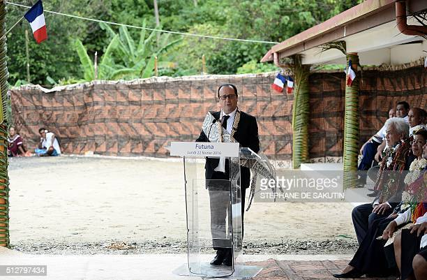 French President Francois Hollande delivers a speech during a ceremony by 'la grande chefferie du royaume d'Alo' in Futuna island on February 22 in...