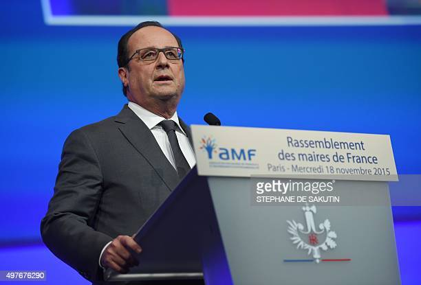 French President Francois Hollande delivers a speech during a meeting of French mayors in Paris on November 18 2015 Hollande urged the nation not to...