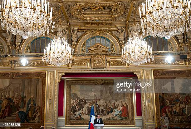 French President Francois Hollande delivers a speech during a ceremony marking the 50th anniversary of the 'Ordre national du Merite' at the Elysee...