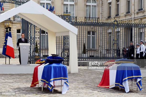 TOPSHOT French President Francois Hollande delivers a speech during a memorial ceremony honouring the police couple who were killed by an extremist...