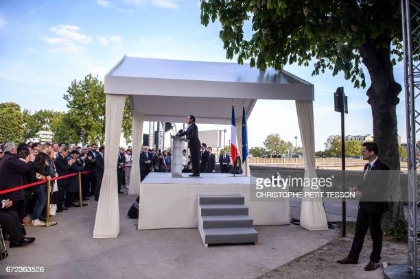 French President Francois Hollande delivers a speech during a ceremony marking the 102nd anniversary of the Armenian genocide in Paris on April 24...
