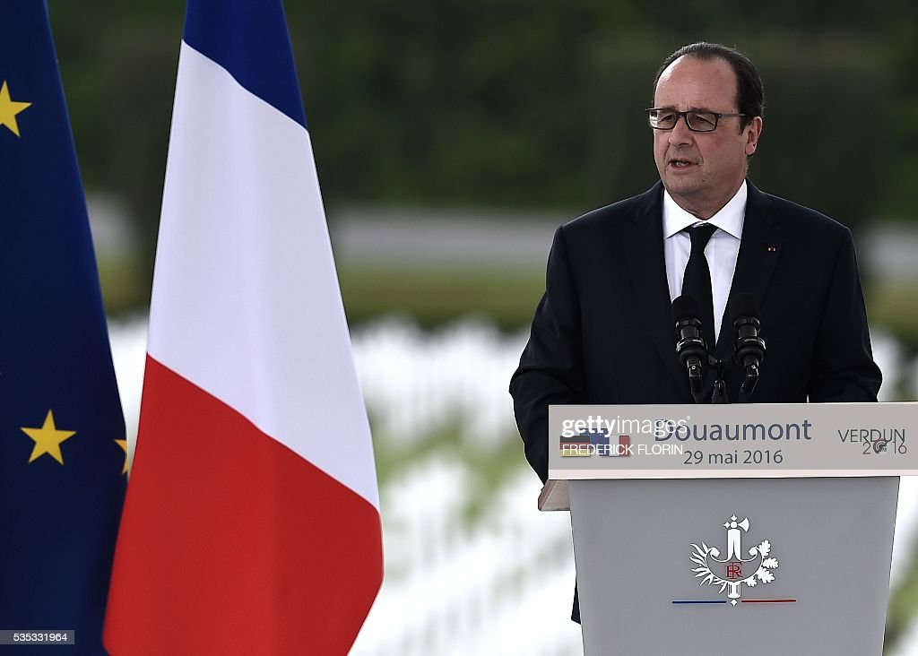 French President Francois Hollande delivers a speech during a remembrance ceremony to mark the centenary of the battle of Verdun, at the Douaumont Ossuary (Ossuaire de Douaumont), northeastern France, on May 29, 2016. The battle of Verdun, in 1916, was one of the bloodiest episodes of World War I. The offensive which lasted 300 days claimed more than 300,000 lives. / AFP / FREDERICK