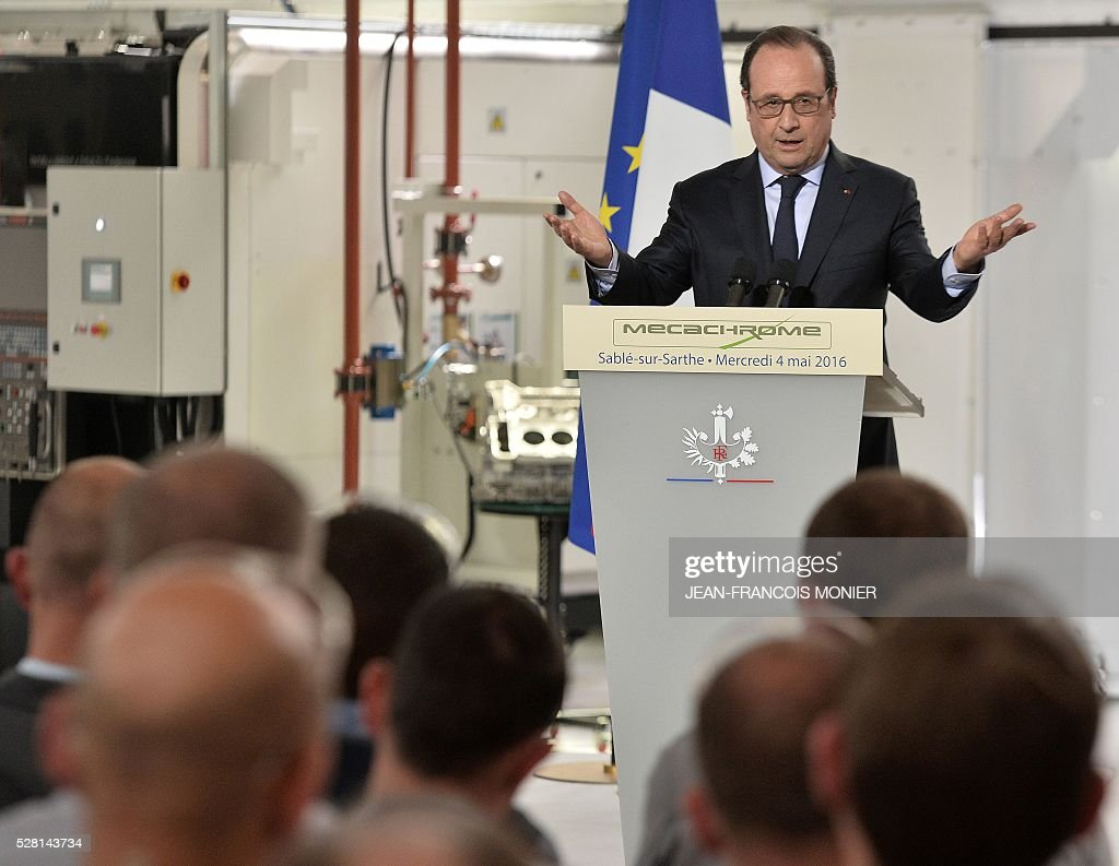 French President Francois Hollande delivers a speech during a visit at the MK Automotive Mecachrome plant, on May 4, 2016 in Sable-sur-Sarthe, northwestern France. / AFP / JEAN