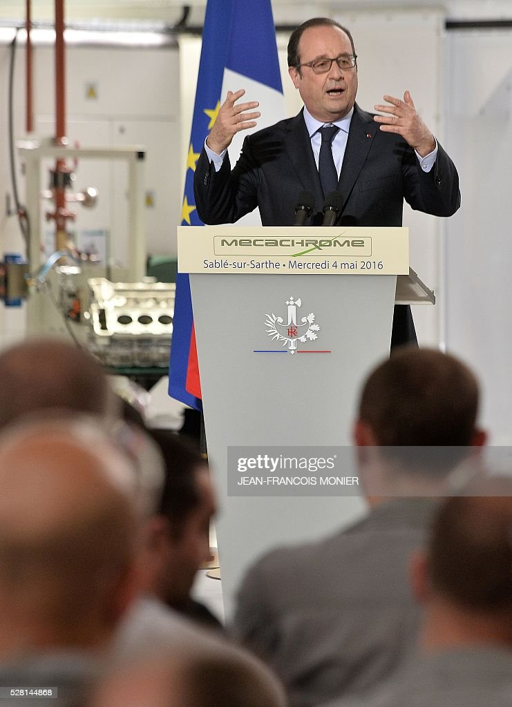 French President Francois Hollande delivers a speech during a visit at the MK Automotive Mecachrome plant on May 4, 2016 in Sable-sur-Sarthe, northwestern France. / AFP / JEAN