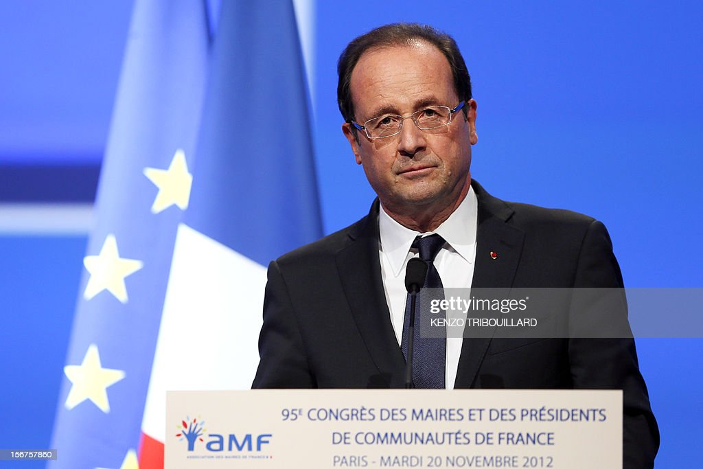 French President Francois Hollande delivers a speech during the opening ceremony of the 95th French Mayors congress, on November 20, 2012 in Paris. AFP PHOTO KENZO TRIBOUILLARD