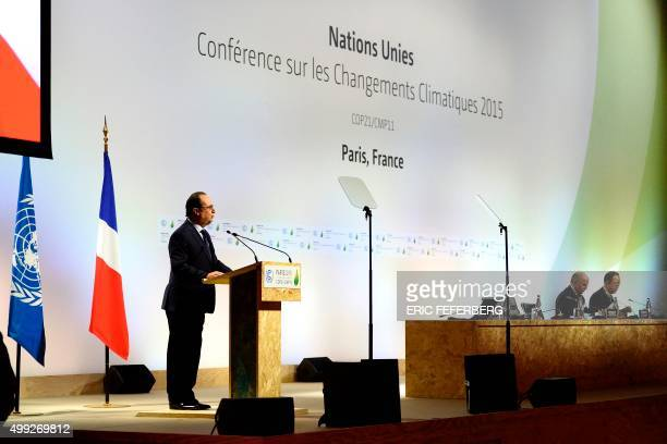 French President Francois Hollande delivers a speech during the plenary session of the COP 21 United Nations conference on climate change on November...