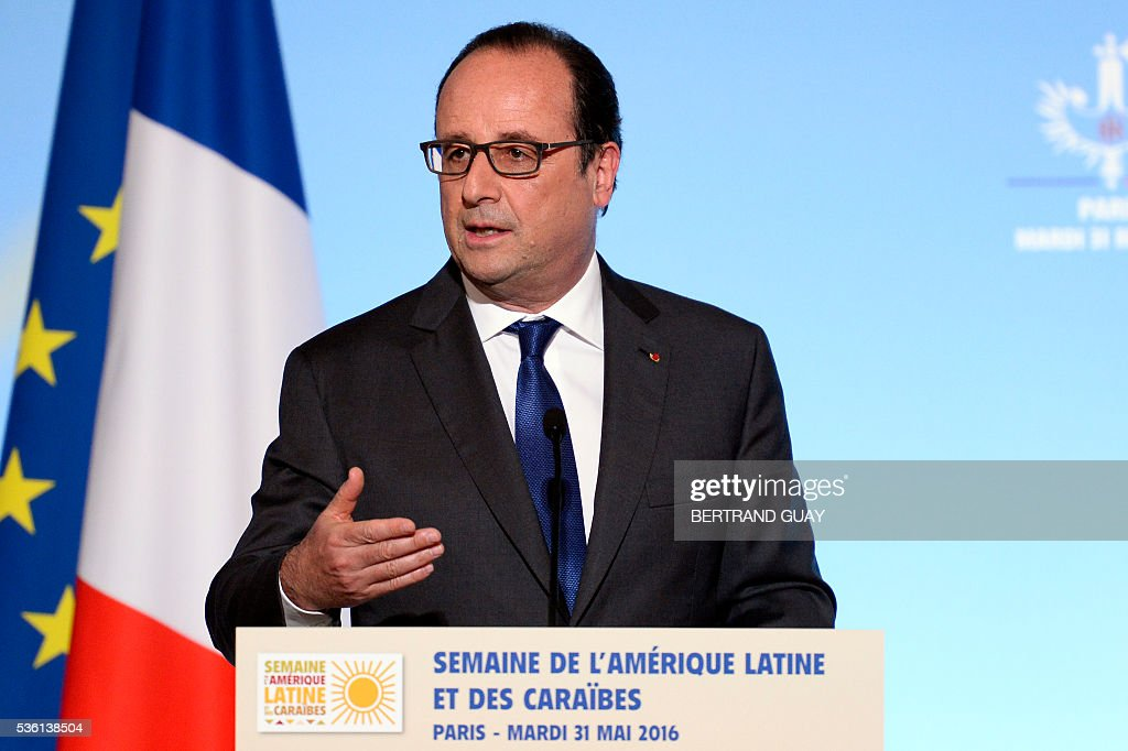 French President Francois Hollande delivers a speech during the opening of the Latin America and Caribbean Week at the Elysee Palace in Paris on May 31, 2016. / AFP / POOL / BERTRAND