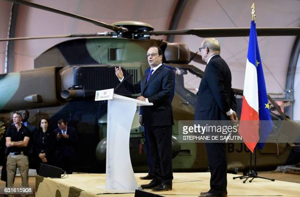 French President Francois Hollande delivers a speech next to French Defence Minister JeanYves Le Drian to the troops of France's Barkhane...