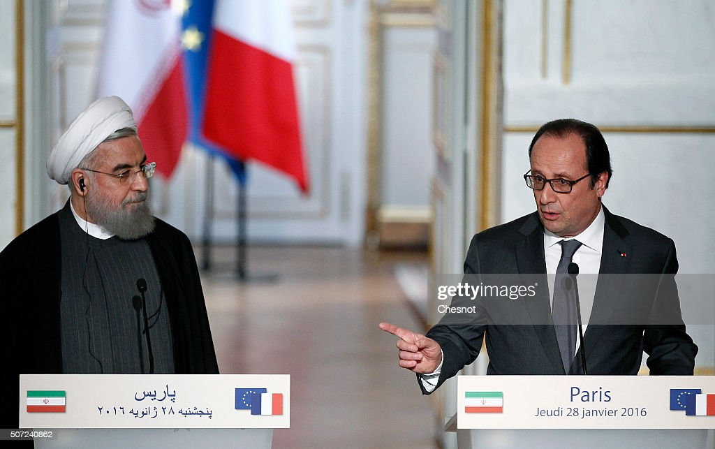 French President Francois Hollande (R) delivers a speech next to Iranian President Hassan Rouhani during a press conference at the Elysee Presidential Palace on January 28, 2016 in Paris, France. Hassan Rouhani is to make the first state visit to France by an Iranian president in nearly two decades following the lifting of sanctions against his country.
