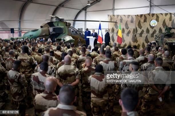 French President Francois Hollande delivers a speech next to Malian Prime Minister Modibo Keita and French Defence Minister JeanYves Le Drian to the...