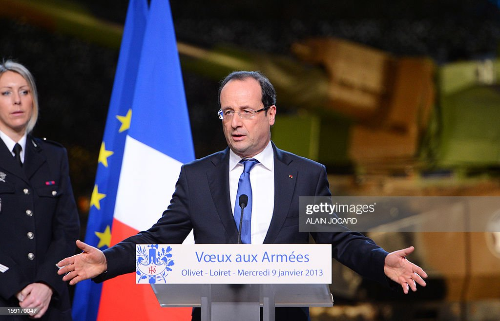 French president Francois Hollande delivers a speech on January 9, 2013 in Olivet, near Orleans, central France, as part of a visit to present his New Year's wishes to the French armed forces.