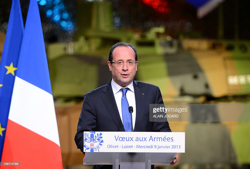 French president Francois Hollande (C) delivers a speech on January 9, 2013 in Olivet, near Orleans, central France, as part of a visit to present his New Year's wishes to the French armed forces.