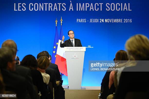 French president Francois Hollande delivers a speech on social contracts of employment at the end of the Conference on the social impact investment...