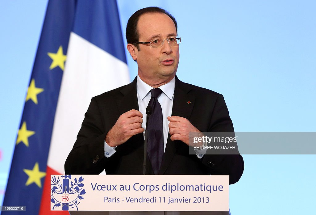 French President Francois Hollande delivers his speech as he attends a New Year wishes ceremony for diplomats at the Elysee Palace in Paris, on January 11, 2013.