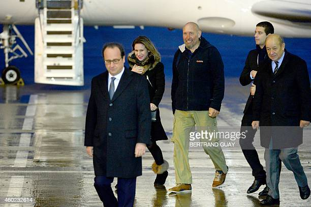 French President Francois Hollande Diane Lazarevic her father Serge Lazarevic France's last remaining hostage Clement Verdon the son of French...