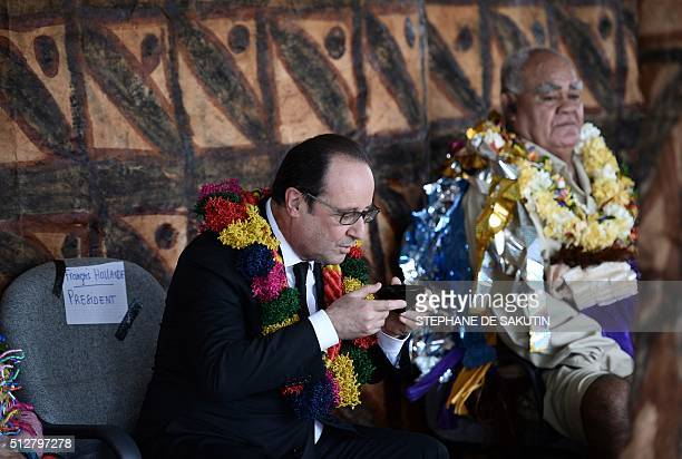 French President Francois Hollande drinks Kava beverage during a ceremony by 'la grande chefferie du royaume d'Uvea' in Wallis island on February 22...