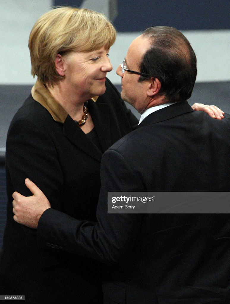 French President Francois Hollande (R) embraces German Chancellor Angela Merkel during a joint session of the German Bundestag and French Assemblee Nationale parliaments in the Reichstag building during the 50th anniversary celebration of the Elysee Treaty on January 22, 2013 in Berlin, Germany. The treaty, concluded in 1963 by Charles de Gaulle and Konrad Adenauer in the Elysee Palace in Paris, set a new tone of reconciliation between France and Germany, and called for consultations between the two countries to come to a common stance on policies affecting the most important partners in Europe as well as the rest of the region. Since its establishment, the document for improved bilateral relations has been seen by many as the driving force behind European integration.