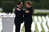 French President Francois Hollande embraces German Chancellor Angela Merkel during a remembrance ceremony to mark the centenary of the battle of...