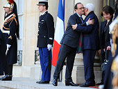 French President Francois Hollande embraces Palestinian president Mahmoud Abbas after their meeting at Elysee Palace on April 15 2016 in Paris France...