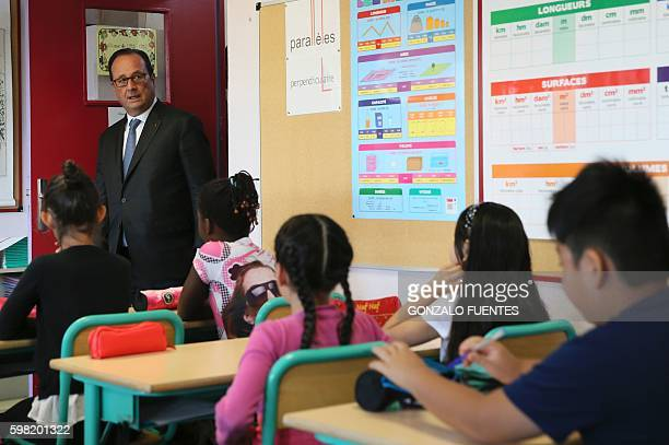 French President Francois Hollande enters a classroom during a visit of the primary school Nécotin for the first day of the starting of the school...