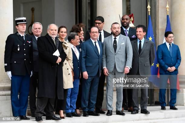 French President Francois Hollande escorts back King Mohammed VI of Morocco flanked by French Foreign Minister JeanMarc Ayrault Moroccan writer Tahar...