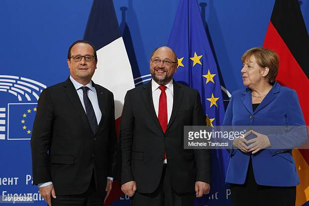 French president Francois Hollande EU Parliament's President Martin Schulz and Germany's Chancellor Angela Merkel pose ahead of their joint speech to...