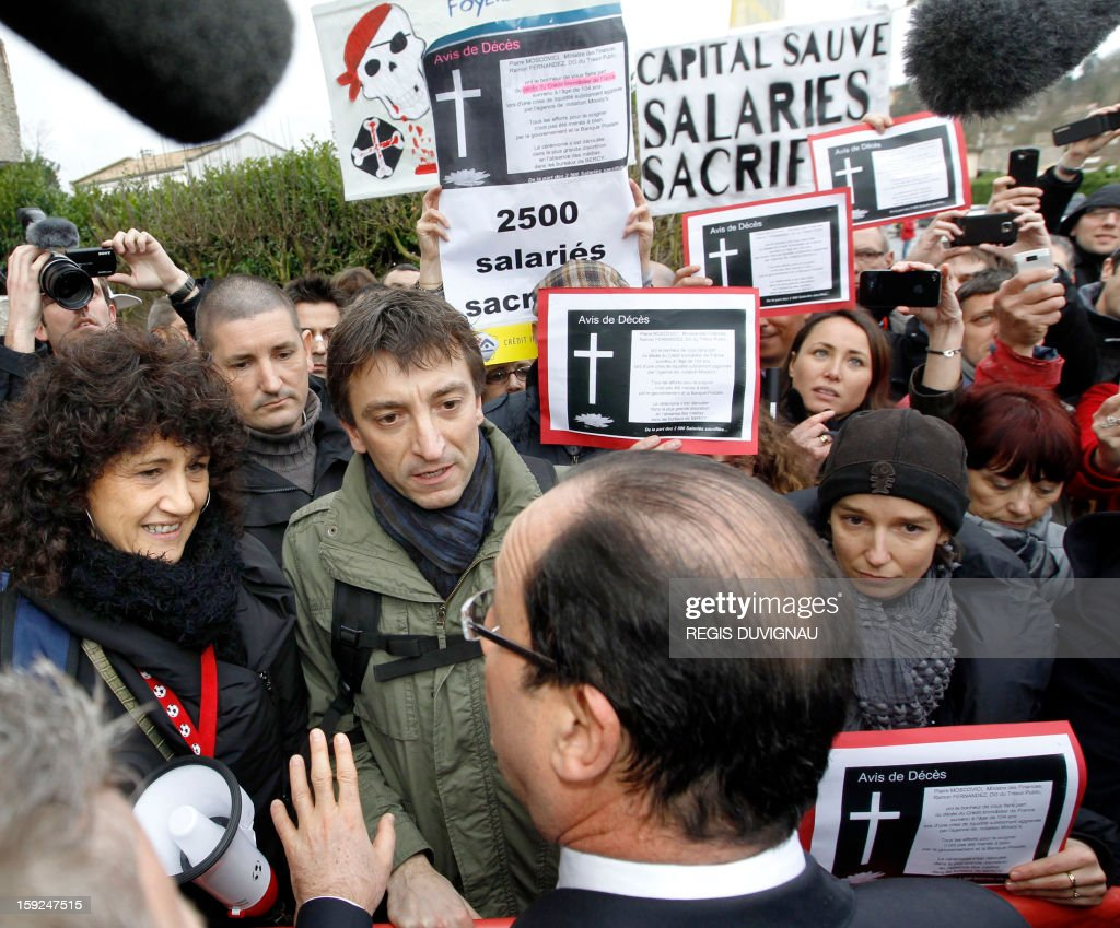 French President Francois Hollande faces demonstrators as he arrives to visit the Aerocampus manufacture in Latresne near Bordeaux, southwestern France, on January 10, 2013. Hollande was in the region for a visit dedicated to future investments and high-tech companies. POOL