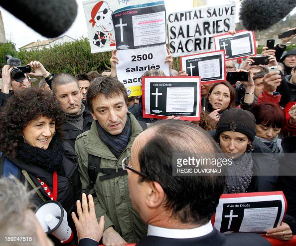 French President Francois Hollande faces demonstrators as he arrives to visit the Aerocampus manufacture in Latresne near Bordeaux southwestern...