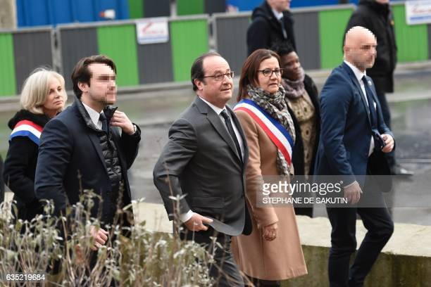 French President Francois Hollande flanked by Aubervilliers' mayor Meriem Derkaoui and French member of Parliament Elisabeth Guigou visits...