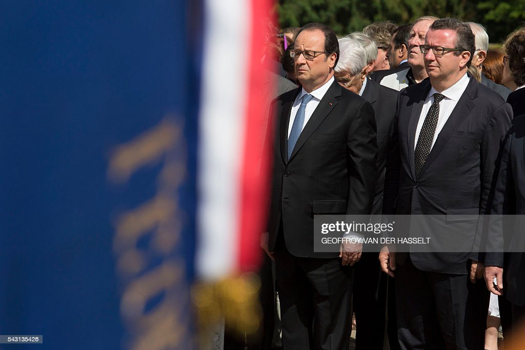 French President Francois Hollande, flanked by Christan Paul (R) member of parliament of the socialit party, looks on during the inauguration ceremony of the memorial of Dun-les-Places in tribute of the victims killed during the Second World War in Dun-les-Places on June 26, 2016. / AFP / GEOFFROY