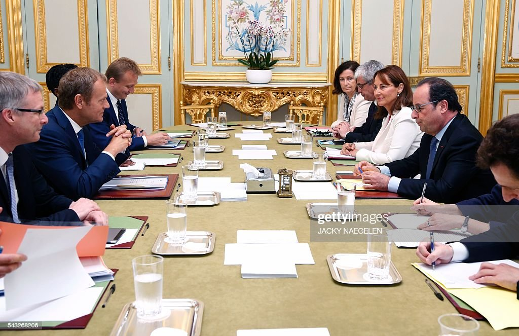 French President Francois Hollande (R), flanked by French Environment Minister Segolene Royale (2nd R), attends a meeting with European Council President Donald Tusk (2nd L) at the Elysee Palace in Paris, on June 27, 2016. Britons voted by 52 percent to 48 percent in favour of leaving the European Union in a vote that sent shockwaves through the financial markets, toppled Cameron and put world leaders in crisis mode. / AFP / POOL / JACKY