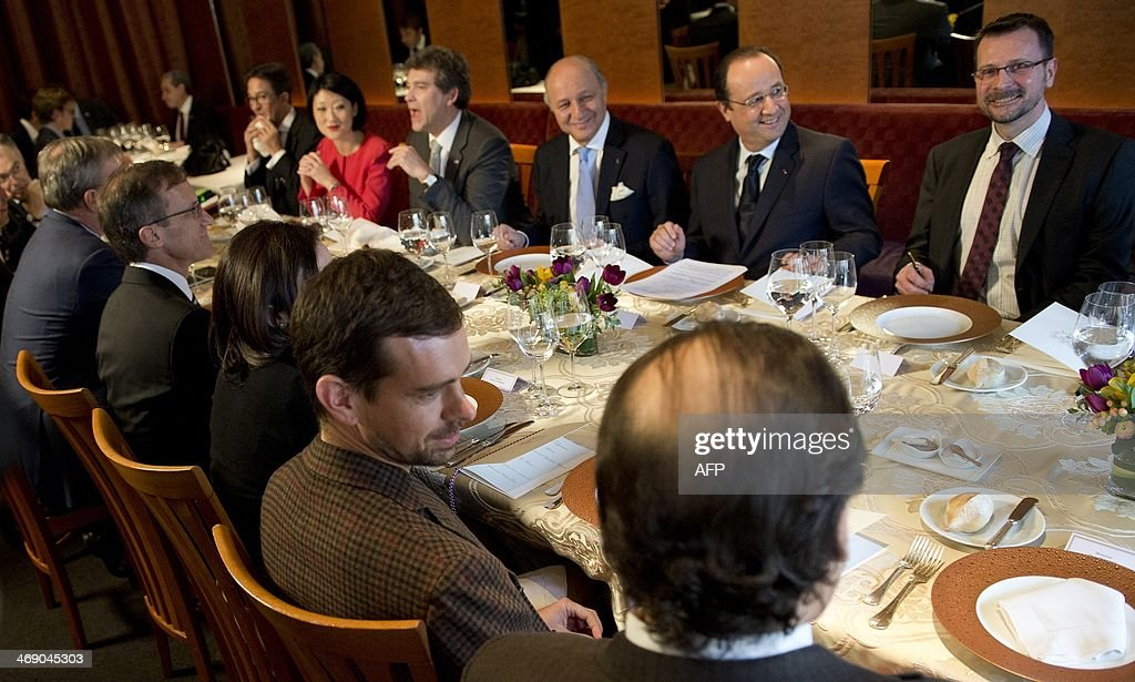 French President Francois Hollande (2nd R), flanked by French Foreign Minister Laurent Fabius (C), has lunch with Twitter founder Jack Dorsey (2nd L) and other businesmen at the restaurant 'La Folie' in San Francisco on February 12, 2014. Hollande is on the last day of a three-day state visit to the United States.