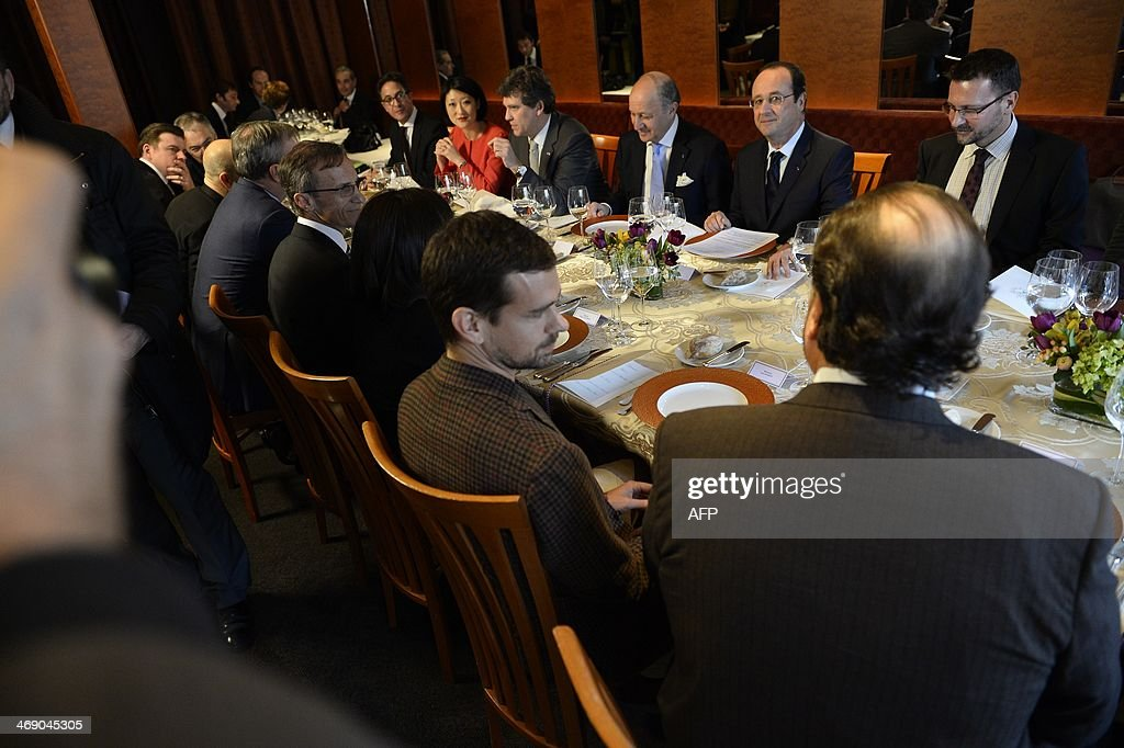 French President Francois Hollande (2nd R), flanked by French Foreign Minister Laurent Fabius (3rd R), has lunch with Twitter founder Jack Dorsey (2nd L) and other businesmen at the restaurant 'La Folie' in San Francisco on February 12, 2014. Hollande is on the last day of a three-day state visit to the United States.