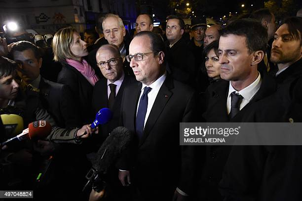 French President Francois Hollande flanked by French Interior Minister Bernard Cazeneuve and French Prime Minister manuel Valls addresses reporters...