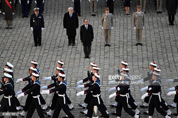 French President Francois Hollande flanked by French junior minister for Veterans JeanMarc Todeschini and Pierre de Villiers French Chief of the...
