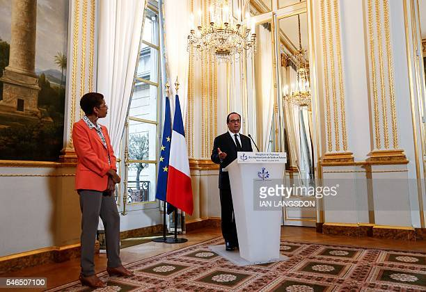 French President Francois Hollande flanked by French Minister for the Overseas Territories George PauLangevin delivers a speech as he attends a...