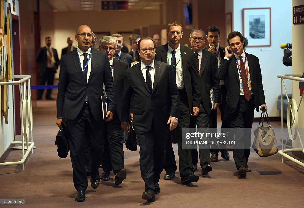 French President Francois Hollande (C), flanked by French Minister of State for European Affairs Harlem Desir (L), arrives for a press conference during an European Union summit on June 29, 2016 at the European Union headquarters in Brussels. EU leaders agreed on June 29, 2016 that Britain cannot have access to the single market after leaving the union without accepting the bloc's rules on free movement, president Donald Tusk said. The summit will come just days after Britain's ruling Conservative party is due to choose a successor to Cameron, who resigned after his country voted in a referendum to leave the EU by 52 percent to 48. / AFP / STEPHANE