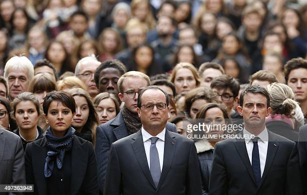 French President Francois Hollande flanked by French Prime Minister Manuel Valls and French Education Minister Najat VallaudBelkacem stands among...