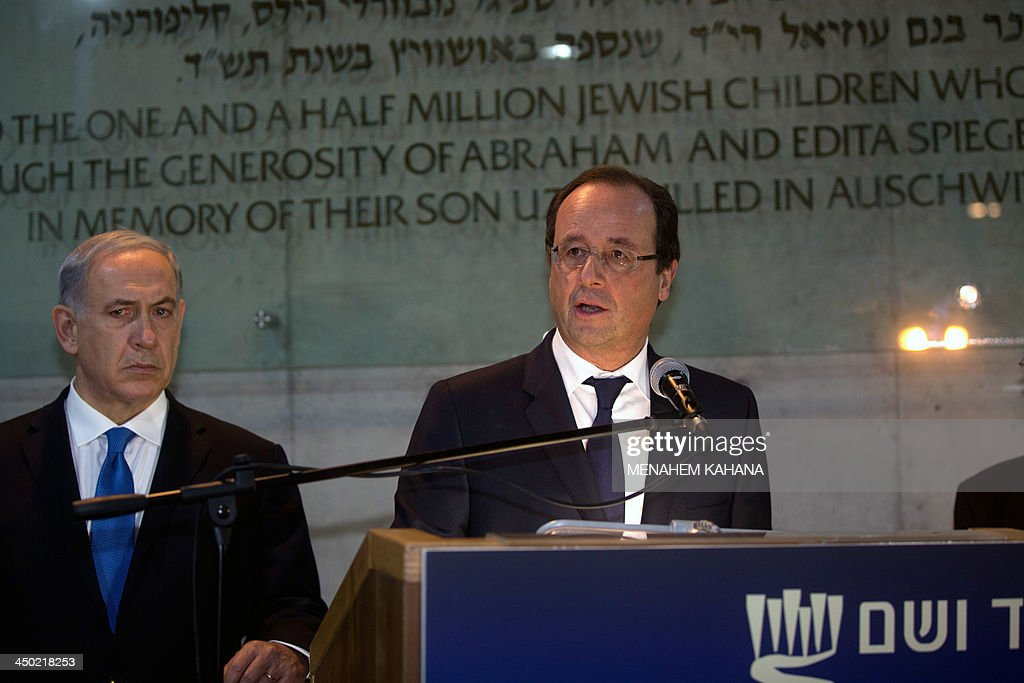 French President Francois Hollande flanked by Israeli Prime Minister Benjamin Netanyahu (L) talks to the press during his visit at the Hall of Remembrance Yad Vashem Holocaust Memorial museum in Jerusalem commemorating the six million Jews killed by the Nazis during World War II on November 17, 2013. AFP PHOTO/POOL/MENAHEM KAHANA